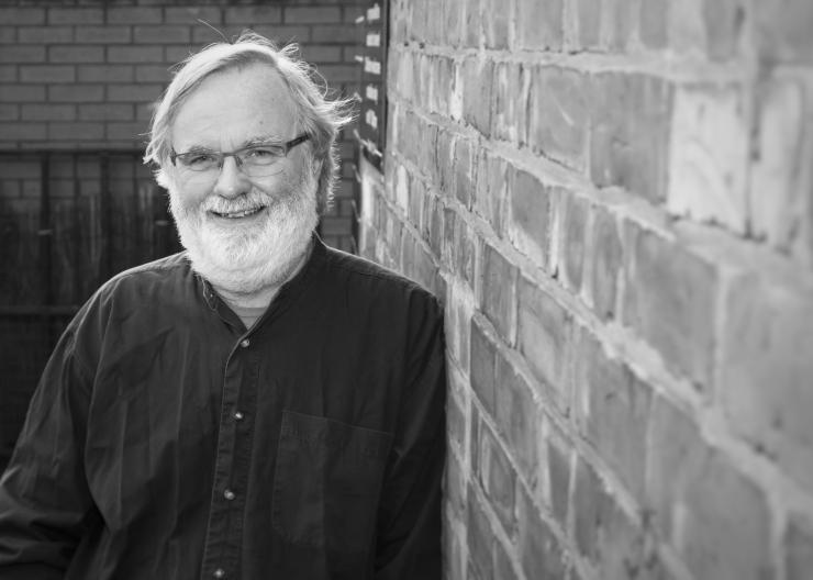 Black and white image of volunteer researcher Stuart Barlow