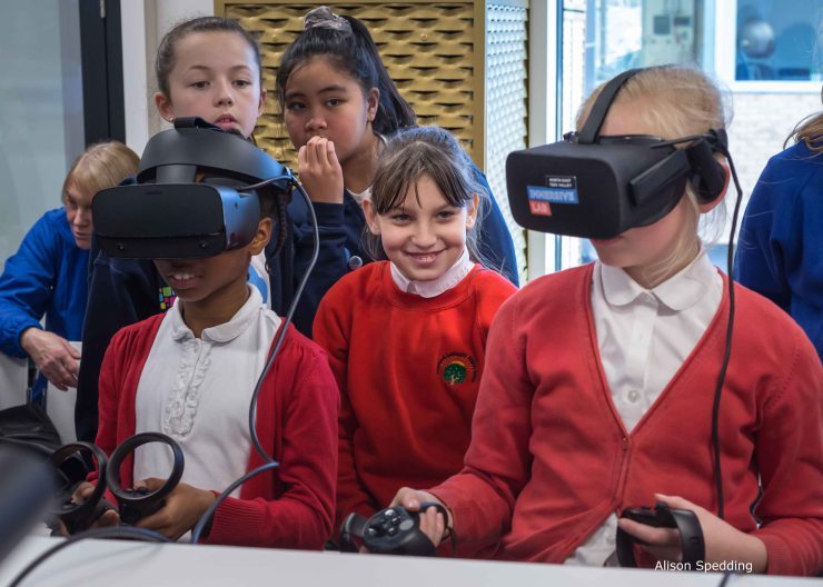 Children watching their friends with VR headsets
